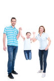Glücklicher Elterngriff der Hand seiner Tochter Stockbild