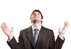 Glücklicher erfolgreicher Geschäftsmann, der oben schaut Lizenzfreie Stockfotos