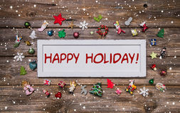 Glücklicher Feiertag - Weihnachtsglückwunschkarte in der unterschiedlichen Farbe Stockfoto