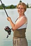 Glücklicher Fisherwoman Stockbilder