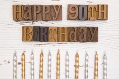 Glücklicher 90. Geburtstag buchstabiert in der Art Satz Stockbilder