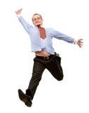 Glücklicher Geschäftsmann, der in die Luft springt Stockfotos