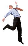 Glücklicher Geschäftsmann, der in die Luft springt Stockbild