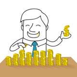 Glücklicher Geschäftsmann, der Goldmünzen zählt Stockbilder