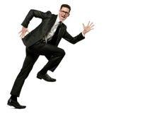 Glücklicher Geschäftsmann läuft in schwarze Klage auf Weiß. Stockfotografie