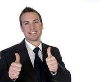 Glücklicher Geschäftsmann mit seinen Handgehenden Daumen oben Stockbilder