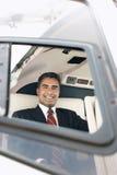 Glücklicher Geschäftsmann Travelling Through Helicopter Stockbilder