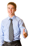 Glücklicher gestikulierender Geschäftsmann Stockfoto