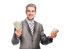 Glücklicher grau-haariger Mann mit Geld Lizenzfreie Stockfotografie