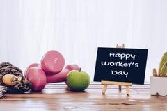 Glücklicher internationaler Arbeitskraft ` s Tag mit Übungs-Eignung gesundes L Lizenzfreies Stockfoto