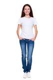 Glücklicher Jugendlicher im weißen T-Shirt und in den Jeans Lizenzfreie Stockfotos