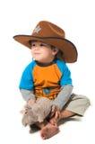 Glücklicher Junge im Cowboyhut stockfotos
