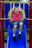 Glücklicher Junge im Spielplatz Stockbilder