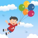 Glücklicher Junge mit Ballonen Stockfotos