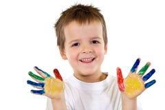 Glücklicher Junge mit den gemalten Händen Lizenzfreies Stockbild