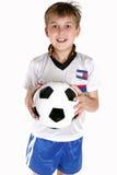 Glücklicher Junge mit einer Fußballkugel Stockfotos