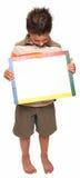 Glücklicher Junge mit trockenem Löschen-Vorstand Stockfotografie