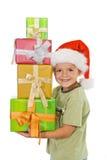 Glücklicher Junge am Weihnachten mit Geschenken Stockbilder