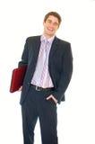Glücklicher junger Geschäftsmannholdinglaptop und -c$lächeln lizenzfreies stockbild