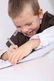 Glücklicher junger Junge an der Schule Lizenzfreie Stockfotos