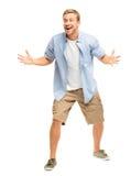 Glücklicher junger Mann, der Erfolg auf weißem Hintergrund feiert lizenzfreies stockfoto