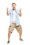 Glücklicher junger Mann, der Erfolg auf weißem Hintergrund feiert lizenzfreie stockbilder
