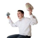 Glücklicher junger Mann gewann eine große Geldsumme Lizenzfreie Stockbilder