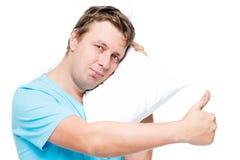 Glücklicher junger Mann mit Kissen Lizenzfreie Stockfotos