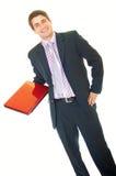 Glücklicher junger stattlicher Geschäftsmannholdinglaptop lizenzfreies stockfoto