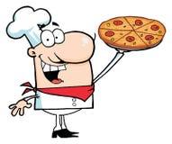 Glücklicher kaukasischer Chef, der seine Pizza-Torte darstellt Lizenzfreie Stockbilder