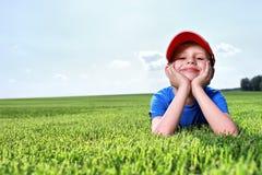 Glücklicher kleiner Junge Stockbild
