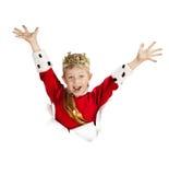 Glücklicher kleiner König Looking heraus vom Papier Stockfotos