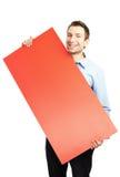 Glücklicher Kursteilnehmer mit unbelegter roter Anschlagtafel stockbild
