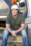 Glücklicher lächelnder Bauarbeiter. Stockbilder