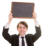 Glücklicher lächelnder jugendlich Junge, der eine leere Tafel hält stockbilder