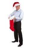 Glücklicher lächelnder Mann im Sankt-Hut mit Strumpf lizenzfreie stockfotos