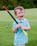 Glücklicher Little Boy-Golfspieler Lizenzfreie Stockbilder