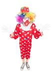 Glücklicher männlicher Clown, der mit den Händen gestikuliert Lizenzfreie Stockfotos