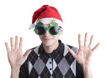 Glücklicher Mann in den Weihnachtsfestgläsern Stockfotografie