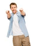 Glücklicher Mann, der weißen Hintergrund zeigt Stockfotos