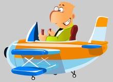 Glücklicher Mann in einem Flugzeug Stockfotografie