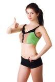 Glücklicher Showdaumen der jungen Frau oben nach Sport Lizenzfreies Stockfoto