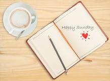 Glücklicher Sonntag auf Notizbuch stockbilder