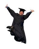 Glücklicher springender Absolvent getrennt lizenzfreie stockfotografie