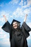 Glücklicher Student im Aufbaustudium im Mantel stockfoto
