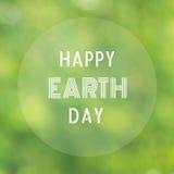 Glücklicher unscharfer Naturhintergrund des Tag der Erde-Buchstaben Stockfotografie