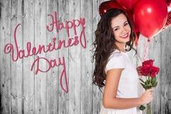 Glücklicher Valentinsgruß-Tag auf einer grauen hölzernen Wand Lizenzfreie Stockfotografie
