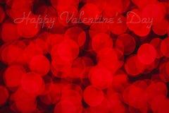 Glücklicher Valentinstag-Text und roter bokeh Effekt für Hintergrund stockbild