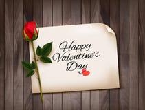 Glücklicher Valentinstaghintergrund mit einer Anmerkung über eine hölzerne Wand Lizenzfreie Stockbilder