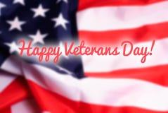 Glücklicher Veteranen-Tag auf USA-Flaggenhintergrund Stockbilder